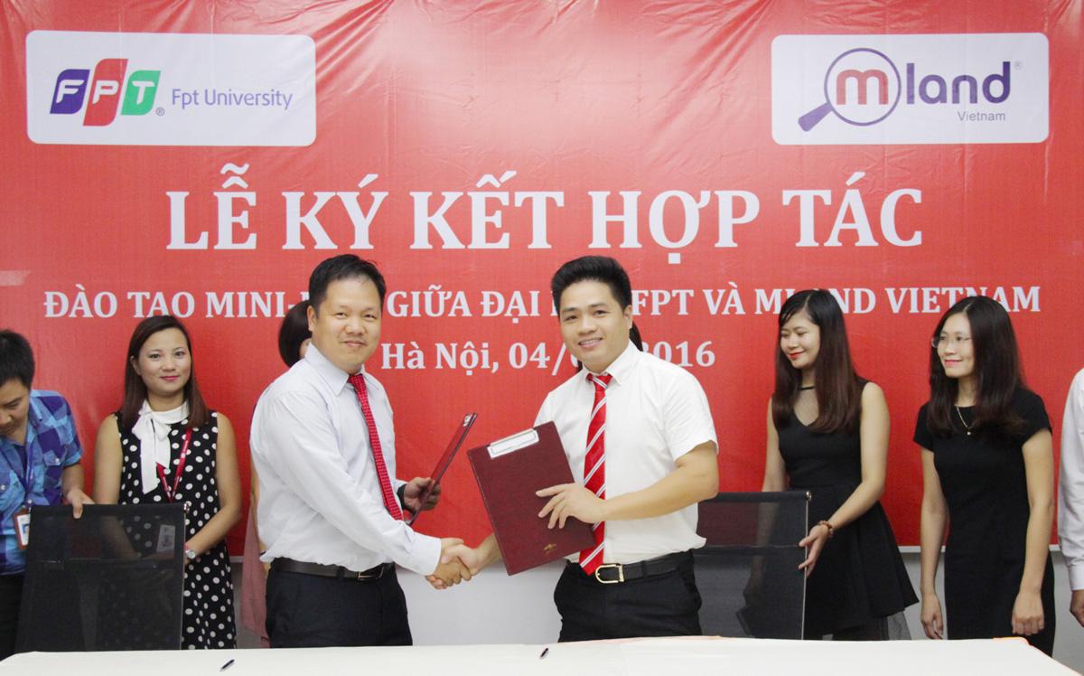 Chủ tịch MLAND Vietnam -  Mai Đức Hùngvà Hiệu trưởng Đại học FPT - Đàm Quang Minh và  Chủ tịch MLand -  Mai Đức Hùng cùng ký kết thỏa thuận hợp tác đào tạo.